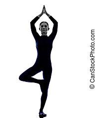 woman exercising Vrksasana tree pose yoga silhouette