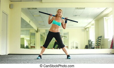 Woman exercising with Body Bar