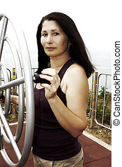 Woman exercising with fitness equip