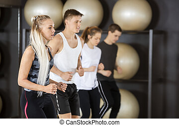 Woman Exercising With Friends In Gym