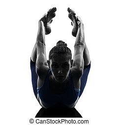 woman exercising yoga bow pose