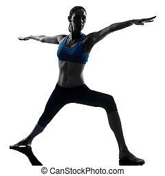 woman exercising yoga warrior position 2