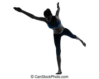 woman exercising yoga warrior position