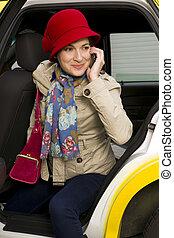 Woman exits a Taxi