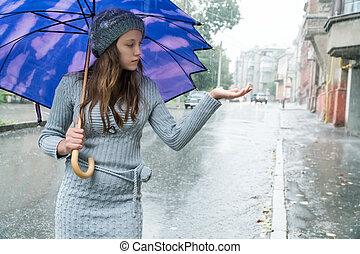 Woman experiences a force rain