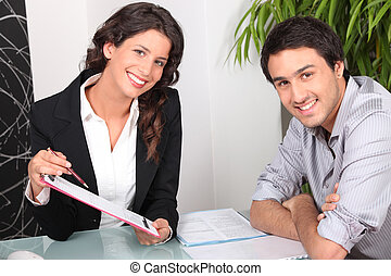 Woman explaining contract to customer