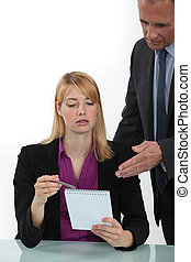 Woman explaining point to boss