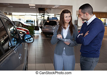 Woman explaining something to a man