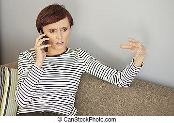 Woman explaining something via the phone