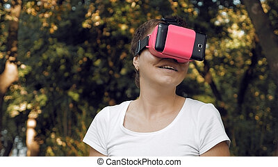 Woman explores virtual reality using VR glasses
