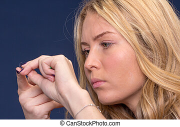 woman exploring contact lenses