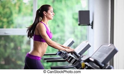 Woman expressing in gym - Woman running on treadmill, sports...