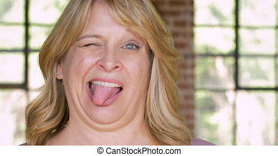 Attractive woman expressing that she is crazy insane loony and out of her mind nuts and psycho