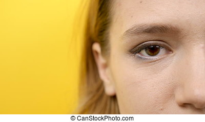 Woman eye in close up of the camera