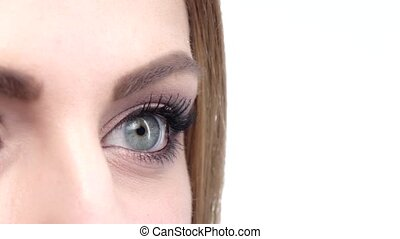 Woman eye makeup isolated on white. Close up. Slow motion