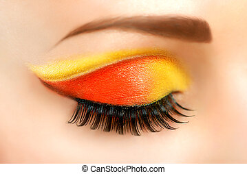 Woman eye with beautiful fashion brigh makeup
