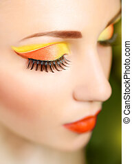 Woman eye with beautiful fashion brigh makeup
