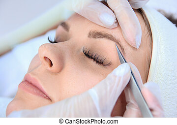 woman eyebrow correction
