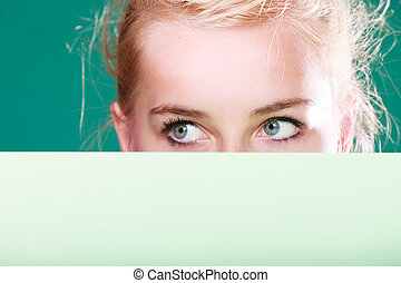 Woman eyes behind white sign