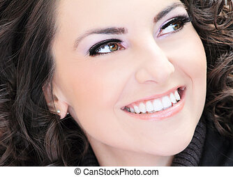 woman eyes with extremely long eyelashes - closeup shot of a...