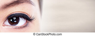Young asian woman eyes close-up looking on abstract background