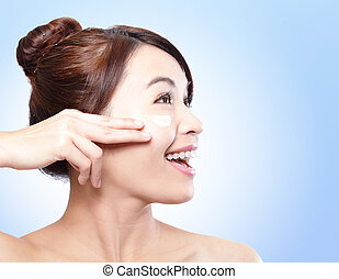 Woman face and apply cream , asian woman