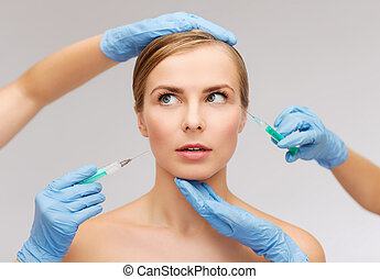 woman face and beautician hands with syringe - healthcare,...