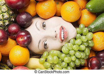Woman face in fruits