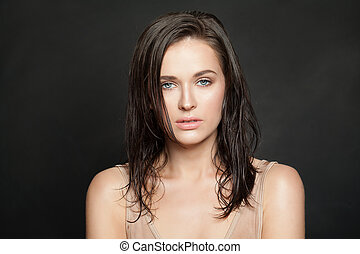 Woman face on black background