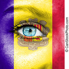 Woman face painted with flag of Andorra