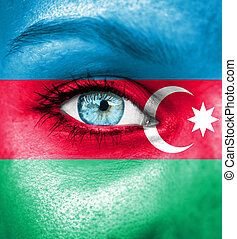 Woman face painted with flag of Azerbaijan