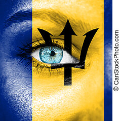 Woman face painted with flag of Barbados