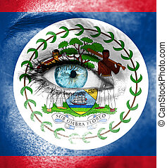 Woman face painted with flag of Belize