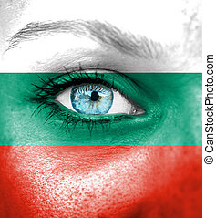 Woman face painted with flag of Bulgaria