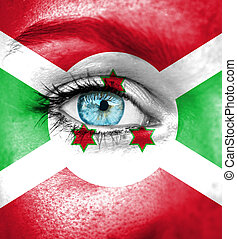 Woman face painted with flag of Burundi