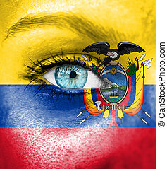 Woman face painted with flag of Ecuador