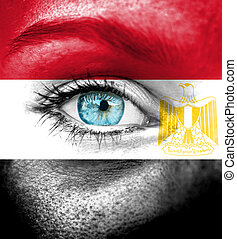 Woman face painted with flag of Egypt