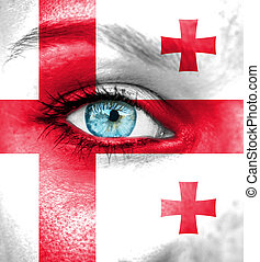 Woman face painted with flag of Georgia