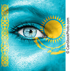 Woman face painted with flag of Kazakhstan