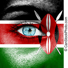 Woman face painted with flag of Kenya