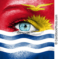Woman face painted with flag of Kiribati