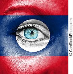 Woman face painted with flag of Laos
