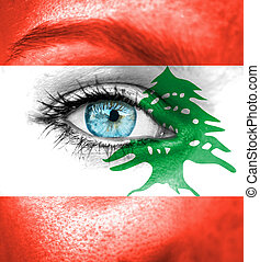 Woman face painted with flag of Lebanon