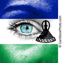 Woman face painted with flag of Lesotho