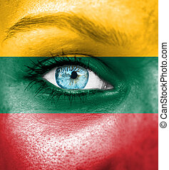 Woman face painted with flag of Lithuania