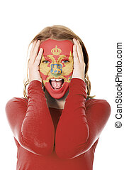 Woman face painted with flag of Montenegro.