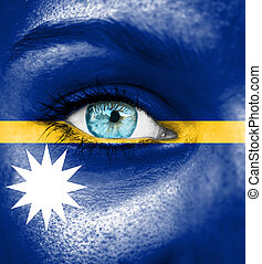Woman face painted with flag of Nauru