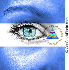Woman face painted with flag of Nicaragua