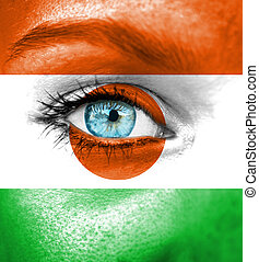 Woman face painted with flag of Niger