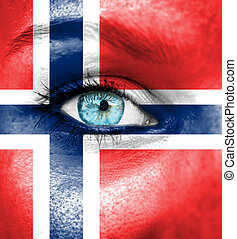 Woman face painted with flag of Norway